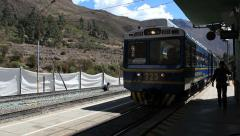 Perurail train between Aguas Calientes and Ollantaytambo in the Andes Cuzco Peru Stock Footage