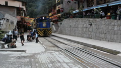 Perurail train between Aguas Calientes and Ollantaytambo in the Andes at Cuzco - stock footage