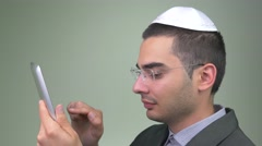 4K Jewish Man Using Tablet Device With Finger Stock Footage