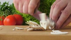 Cooking - cutting mushrooms in the kitchen. Stock Footage
