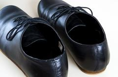 Black male leather shoes Stock Photos