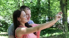 Stock Video Footage of Young couple taking a self portrait