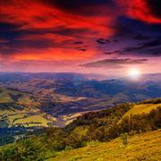 Light  beam falls on hillside with autumn forest in mountain on sunset Stock Photos