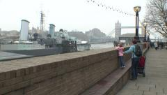 952. London. Mother and child looking on a ship in front of Tower Bridge - stock footage