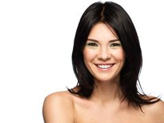 portrait of a young beautiful positive brunette woman with make-up isolated o - stock photo