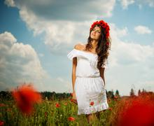 Beautiful young brunette girl wearing white summer dress and flower chaplet i Stock Photos