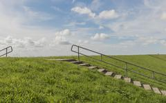 dike and stairs texel - stock photo
