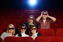 Group of people in 3d glasses watching movie in cinema Stock Photos