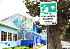 street sign showing evacuation way in case of tsunami - stock photo
