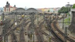 Train departs from main railway station - with city (buildings) and cars Stock Footage