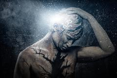 man with conceptual spiritual body art - stock photo