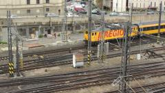 Train departs from main railway station to the tunnel - city Stock Footage