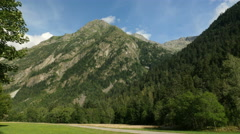 VAN ON SCENIC ROAD IN MOUNTAINS WIDE SHOT Stock Footage