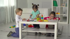 Three Little Friends Drawing Colorful Pictures Stock Footage