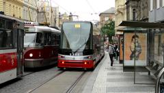 Commuter people - people get in and get off from tram - city (buildings) Stock Footage