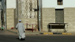 Egypt Red Sea City of Safaga 008 old Egyptian man walks, seen from rear Stock Footage