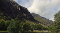 Rocky mountain ridge with vegetation Stock Footage