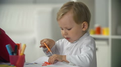 Little Boy Cutting Out FIgure Stock Footage
