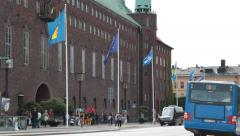 National elections in sweden 2014 - City hall with flags and bus Stock Footage