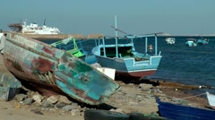 Egypt Red Sea City of Safaga 015 boats on land fall into disrepair Stock Footage