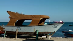 Egypt Red Sea City of Safaga 018 damaged boat on land in a boatyard Stock Footage