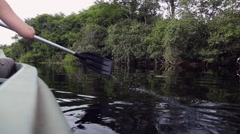 Woman riding canoe in Pantanal River, Brazil Stock Footage