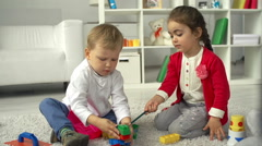 Children on the Playroom Floor Stock Footage