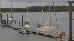 Boats waiting to enter marina - stock footage