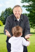 Happy grandpa with open arms Stock Photos