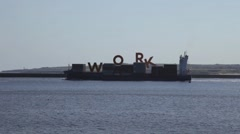 The word work composited onto a container ship - stock footage
