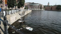 Election posters float in lake by parliament - sweden Stock Footage