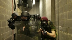 Sas, swat team, armed soldiers walking down corridor, close up, guns aimed. Stock Footage