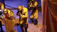 Sas, swat team, armed police soldiers investigating building with guns raised Stock Footage