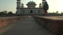 983. India. Agra Indian women walking near temple Stock Footage