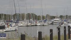 Passing Boats in Marina Stock Footage