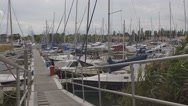 Stock Video Footage of A row of boats docked at a marina