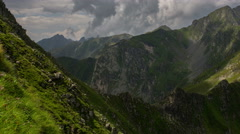 Carpathian mountains storm clouds rising from behind a ridge menacing atmosphere Stock Footage