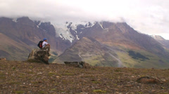 Hiker Sitting On The Rock HD Stock Footage