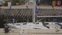 Yacht waiting in lock to marina Stock Footage