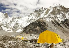 tents in everest base camp in cloudy day, nepal. - stock photo
