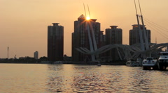 Sunset of a city at seaside Stock Footage
