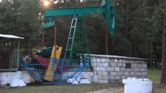 An oil pump jack. Belarus, Brest region, with a tripod, summer, day. Stock Footage