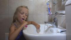 Little Girl Brushing Teeth in Bathroom on Sleeping, Child, Kid with Toothbrush - stock footage