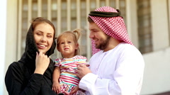 Portrait of a young couple in Arab robes with a small child in her arms. Stock Footage
