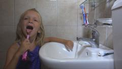 Little Girl Brushing Teeth in Bathroom on Sleeping, Child, Kid with Toothbrush Stock Footage