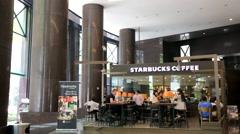 Starbucks coffee at Raffles Place Stock Footage