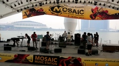 Musicians on the esplanade open scene Stock Footage