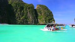 Stock Video Footage of speedboat with tourists at Maya bay, Phi Phi Leh island
