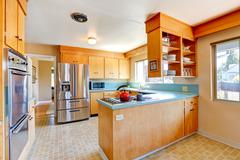 kitchen room with mint tops and steel appliances - stock photo