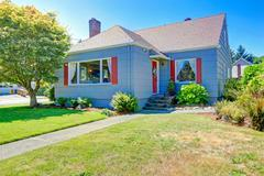 Cozy small house exterior with red details Stock Photos